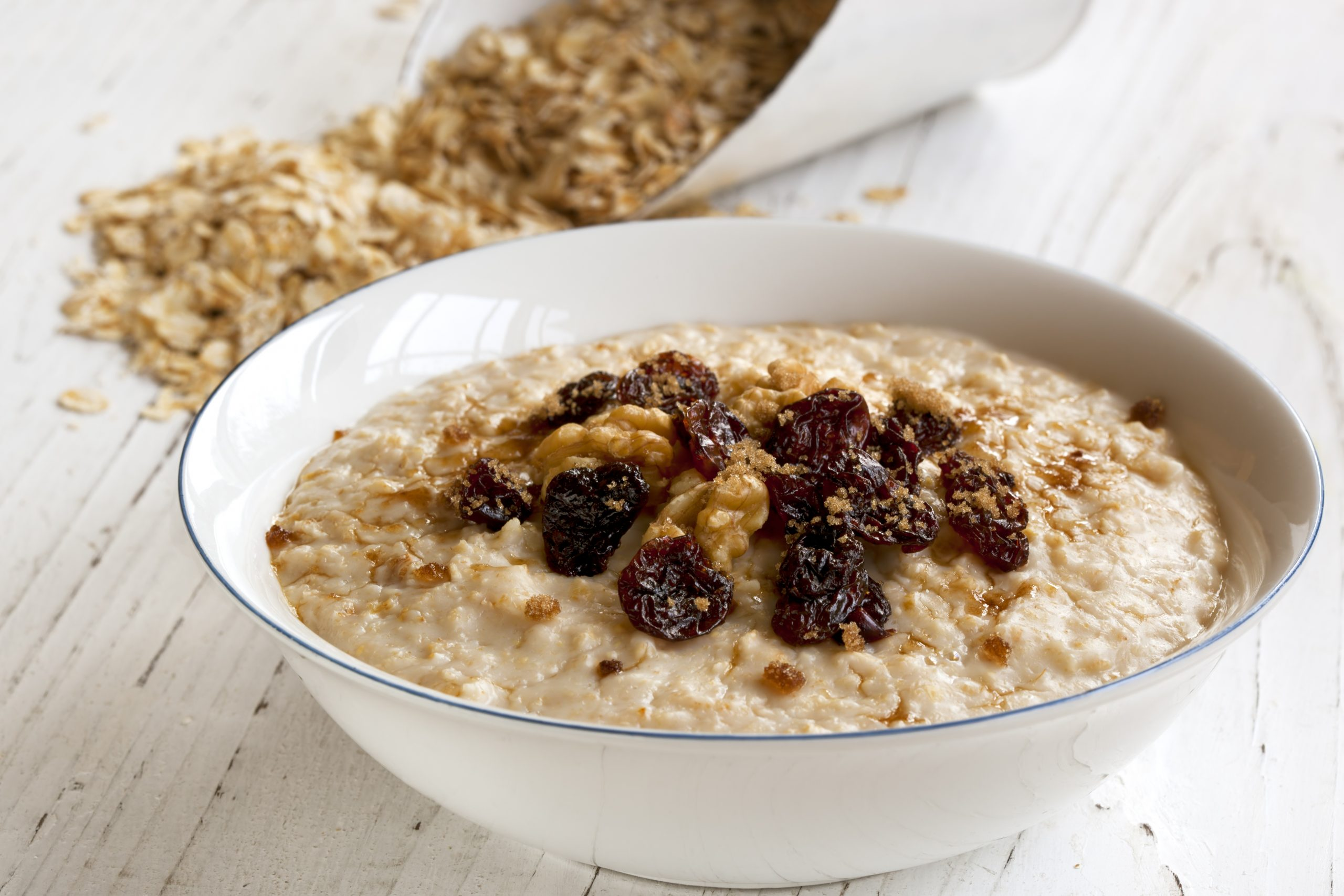 Porridge with walnuts, raisins and brown sugar.  Delicious oatmeal.